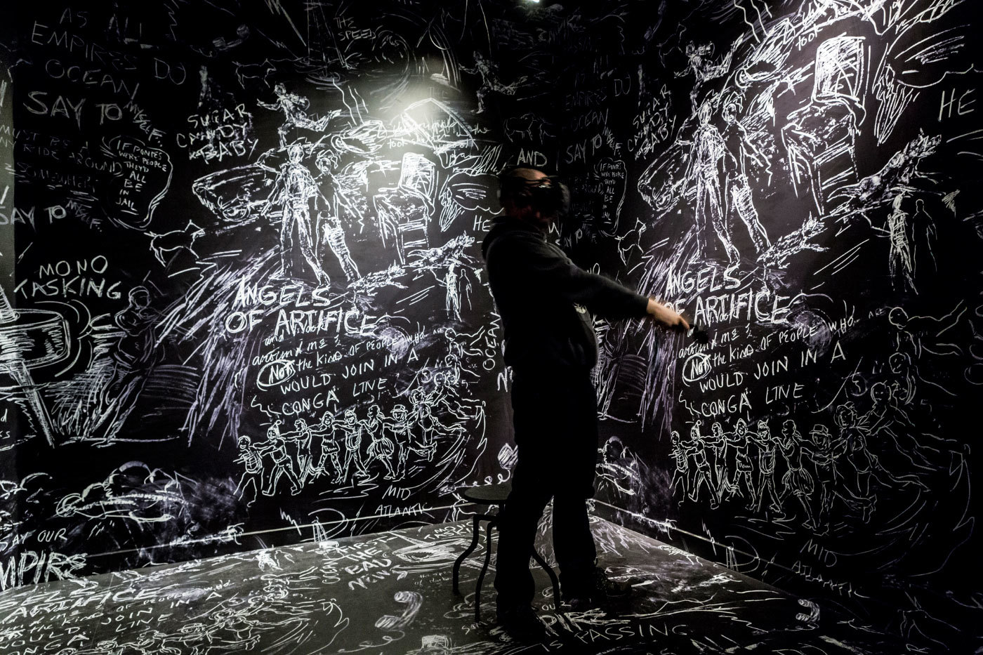 Visitor experiencing Chalkroom, by Laurie Andersoon and Hsin-Chien Huang